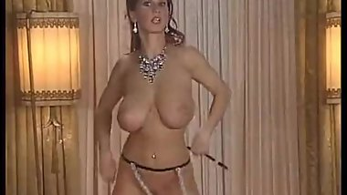 Vintage stripper with perfect breasts gets naked