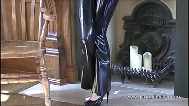 Shiny black latex outfit and fetishwear of sexy cougar Olivi